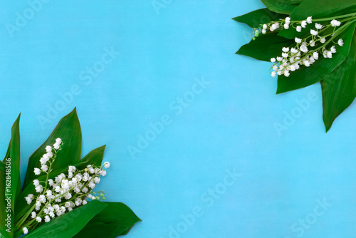 lilies of the valley on a blue background
