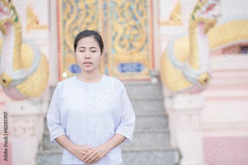 Buddhist Nuns meditation in  thailand. Concept: Lent