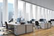 Workplace in an open space office, side
