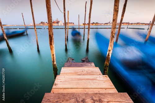 Long exposure of gondolas in the Grand Canal, Venice, Italy