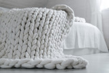 White nordic bedroom interior with knit plaid - 162861154