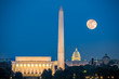 Supermoon above three iconic monuments: Lincoln Memorial, Washington Monument and Capitol Building in Washington DC as viewed from Arlington, Virginia