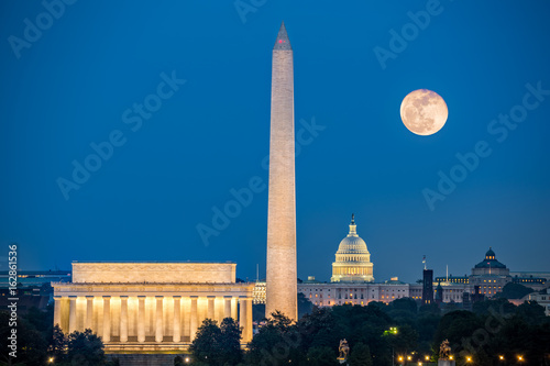 Poster Supermoon above three iconic monuments: Lincoln Memorial, Washington Monument an