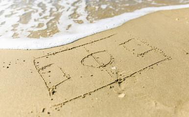 Soccer court drawn on the sand beach © photostocklight