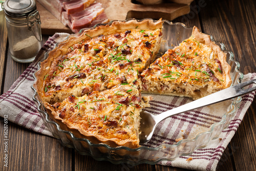 Homemade quiche lorraine with bacon and cheese - 162876912