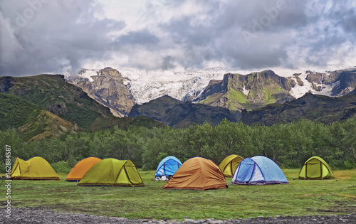 Big tourist camp is located in the valley of the park near the glacier , Iceland