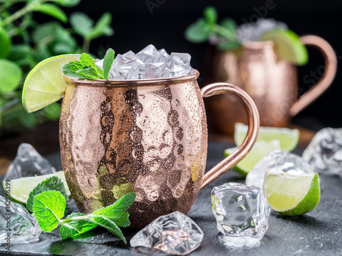 Moscow Mule. Frosty copper mug with lime and ice cubes.