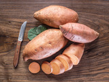 Sweet potatoes on the old wooden table. - 162886521