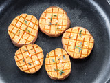 Baked batata on the frying pan. - 162886527