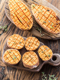 Baked batata on the old wooden table. - 162886533