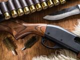 Pump action shotgun, 12 mm hunting cartridge  and hunting knife. - 162886582