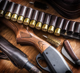 Pump action shotgun, 12 guage cartridge and hunting knife. - 162886592