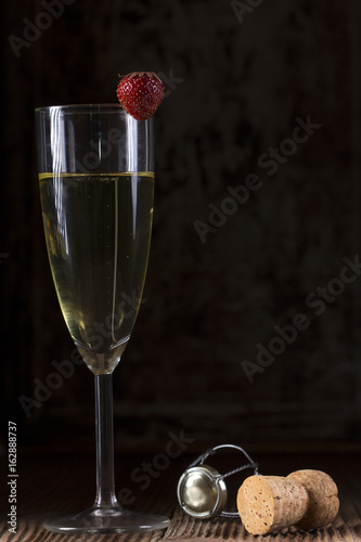 Glass with champagne and strawberry