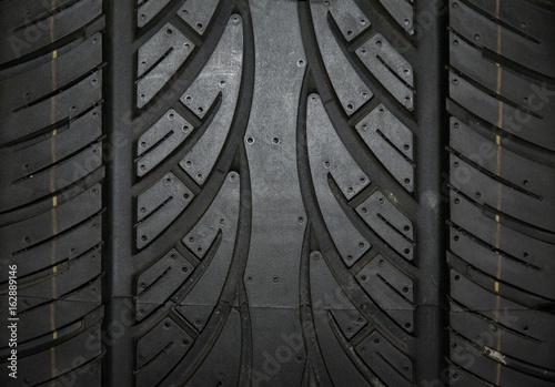 Samochodowej opony tło, opony tekstury zbliżenia tło