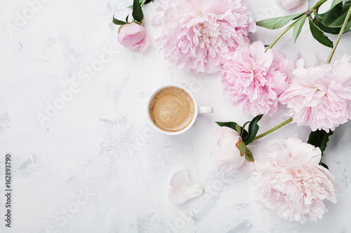 Morning coffee and beautiful pink peony flowers on white stone table top view in flat lay style. Cozy breakfast on Mother or Woman day. - 162893790