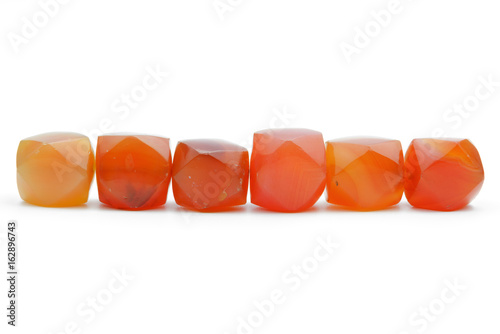 Ancient carnelian beads on white background