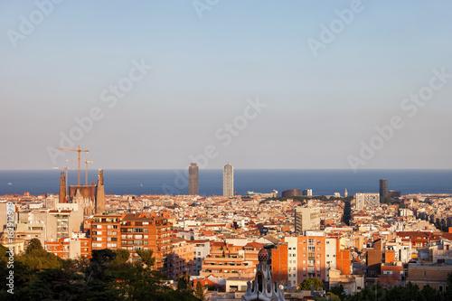 Barcelona cityscape at sunset, horizon of Mediterranean Sea, Catalonia, Spain
