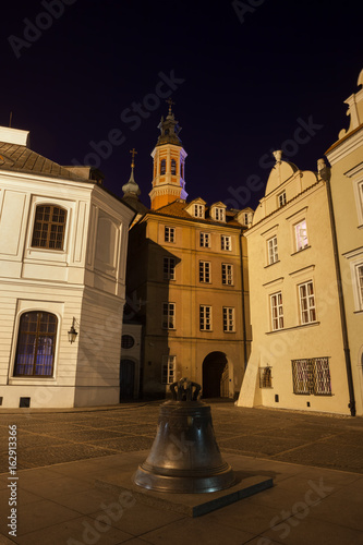 Bell on Kanonia Square in city of Warsaw at Night in Poland