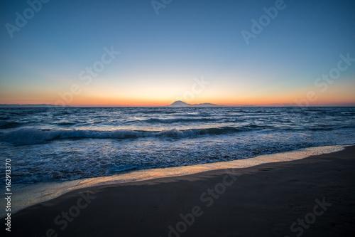 Foto op Canvas Zee zonsondergang Sonnenuntergang am Meer