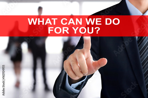 Businessman hand touching WHAT CAN WE DO FOR YOU text on virtual screen Poster