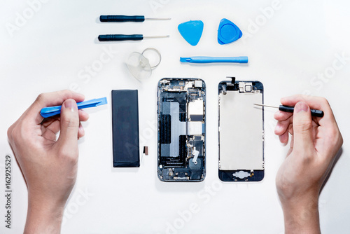 The smartphone was damages and need to repair which tools smartphone that stand isolated on white background by hands of repairman.
