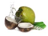 cracked coconut with splashing water on white background