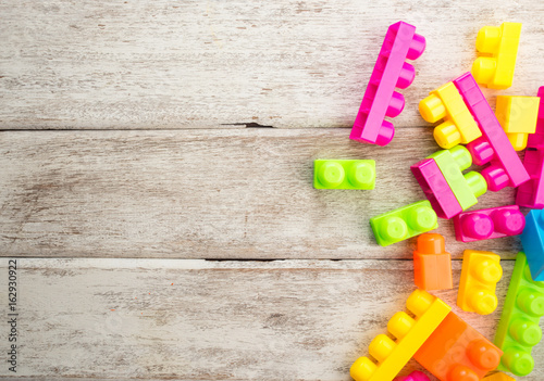 plastic toy blocks on white wood table,children's toy
