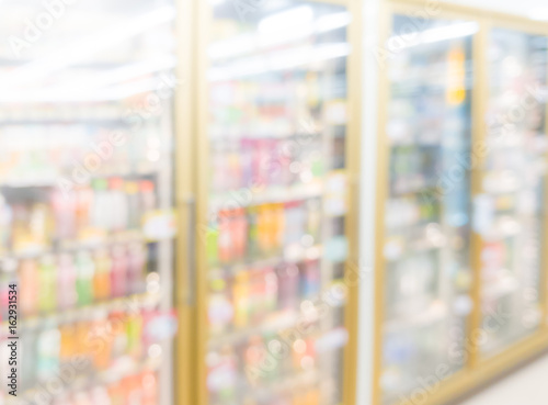 Blurred Interior of Frozen Food with dairy products in Supermarket