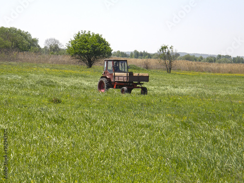 Tractor on a spring meadow.