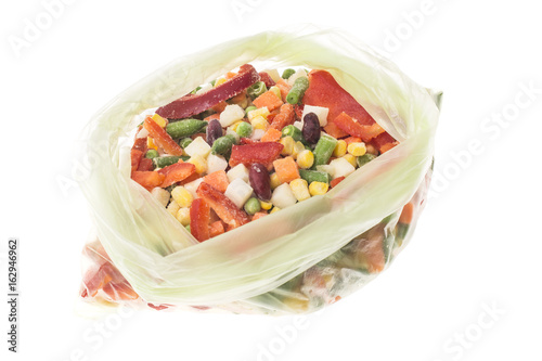 Mix of deep-frozen vegetables in cellophane package.