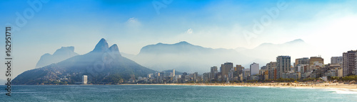 Fotobehang Rio de Janeiro Panoramic landscape of the beaches of Arpoador, Ipanema and Leblon in Rio de Janeiro with sky and the hill Two brothers, Vidigal, and Gávea stone in the background