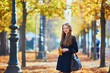 Beautiful young girl in autumn park