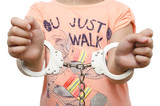 Girl, child in handcuffs isolated