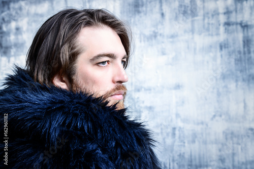 man in fur coat