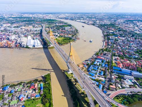 Aerial view of bridge cross river path into city, Bangkok