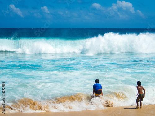 10 Year Old Boys Play In Surf Shipwreck Beach Near Grand Hyatt Koloa