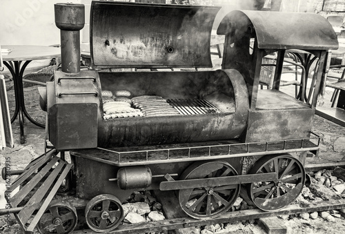 Barbecue grill with meat in shape of old steam locomotive, colorless Poster