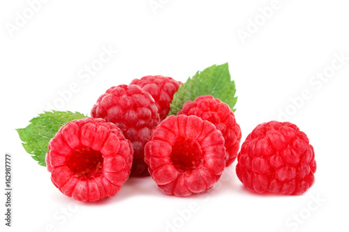 Tasty ripe raspberries on a white background. - 162987777