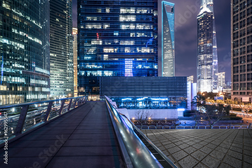 view of footbridge at night in city of China.
