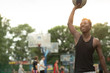 African american man plays on basketball court. Real and authentic activity.