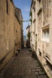One of the side streets running off the main road through Korcula Old Town. - 163006190