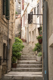 One of the side streets running off the main road through Korcula Old Town. - 163006341