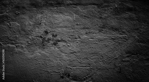 Black plastered rough wall Grunge background