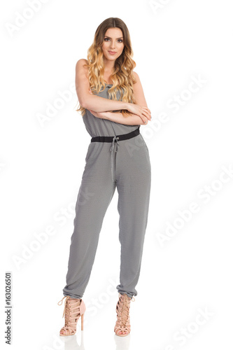 Woman In Jumpsuit And High Heels Isolated