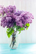 A bouquet of lilacs on the window
