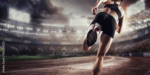 Sport background. Runner on the stadium. Dramatic scene. - 163034523