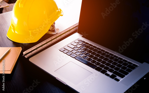 Fototapeta Construction office engineer tablet with computer and notebook