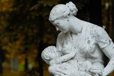 sculpture woman with a baby in the Park - 163046762
