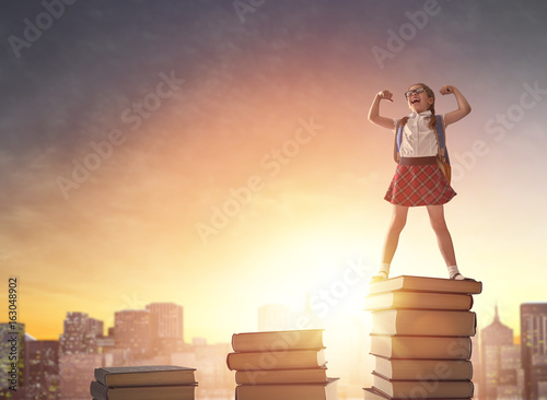 child standing on books