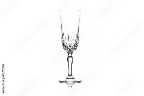 One clean empty champagne glass on white background